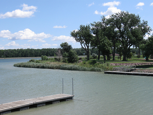 View of Bad Humored Island (so named by William Clark) at Fischers-Lilly Park in Fort Pierre, South Dakota. It is difficult to visualize the frontier confrontation. Black Buffalo's fishing dock is in the foreground.
