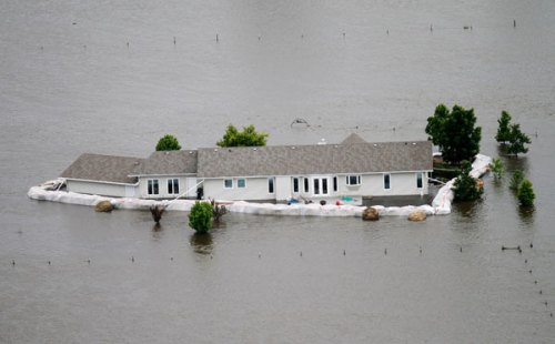 A home is taken by the flood in Minot, North Dakota, June 2011